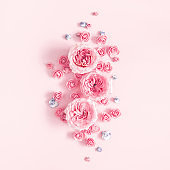 Flowers composition. Pattern made of rose flowers on pastel pink background. Valentines day, mothers day, womens day, spring concept. Flat lay, top view, square