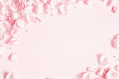 Flowers composition. Rose flower petals on pastel pink background. Valentines day, mothers day, womens day concept. Flat lay, top view, copy space