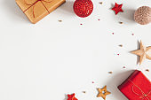Christmas composition. Gifts, red and golden decorations on gray background. Christmas, winter, new year concept. Flat lay, top view, copy space