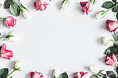 Flowers composition. Pink and white rose flowers on pastel gray background. Valentines day, mothers day, womens day, spring concept. Flat lay, top view, copy space