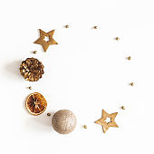 Christmas composition. Wreath made of golden decorations on white background. Christmas, winter, new year concept. Flat lay, top view, copy space, square