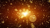 Snowflakes with light in particles. Abstract golden background
