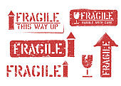 Fragile, this way up, handle with care grungy box signs and symbols for cargo and delivery imprints