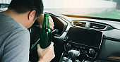 Asian men drink a lot of alcohol until and unconscious his can't drive home and decide to sleep at the steering wheel.