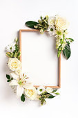 Frame of rose, lily, gerbera flowers over white background. Valentines day, Woman day concept. Spring or summer banner with copy space. Banner
