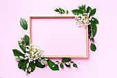 Creative layout with white flowers and copyspace over pink background. Top view, flat lay. Spring and summer concept.
