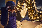 Woman enjoying in the mountain resort, while snowing
