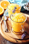 Orange granita, frozen summer dessert and  blooming lavender