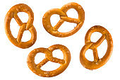 Pretzel with salt. Set or collection of baked pretzels with salt isolated on white background. Snacks for beer