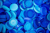 The plastic lid that is left over from the bottles are collected to be recycled into other items for reuse.