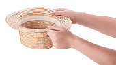 Straw hat in woman hands. concept money for donations