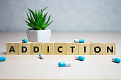 ADDICTION word made with building blocks, medical concept