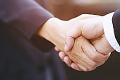 Good deal. Close-up of handshaking. Smooth business.