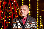 Portrait of grandfather is sitting christmas tree