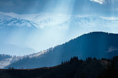 Foggy hills and gloomy mood of the scene of the alpine valley. Location place Carpathian Ukraine, Europe.
