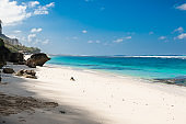 Tropical beach with white sand, blue ocean and sky