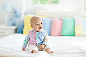 Cute baby on white bed