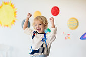 Kids play astronaut. Space and planet child game.
