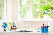 Back to school. Kids desk with books, globe.