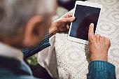 Elderly man using digital tablet