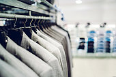 Suits on hanger in store