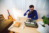 Hipster writer on a coffee break