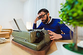 Hipster writer tired of work