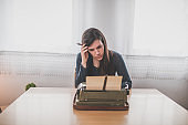 Girl typing a letter