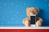 Smart phone and teddy bear
