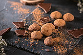 Chocolate truffle candy with cocoa powder