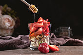 Glass of oatmeal muesli with strawberry and granola