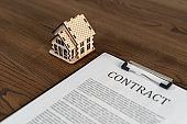 Documents and contract on wooden table in office