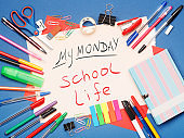Stationery, notebook and paper page with My Monday School Life text on blue background