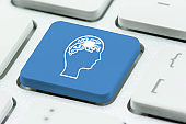 AI artificial intelligence / machine learning concept : Human brain with digital circuit on laptop keyboard button, depict robot with autonomous cognitive function, problem solving and decision making