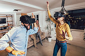 Couple having fun playing with VR