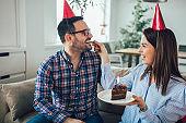 Husband's birthday.Wife surprise his husband with birthday cake .Anniversary.