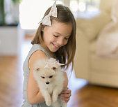Girl holding a Pomeranian puppy