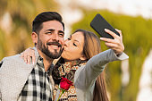 Cute couple smiling while making selfie