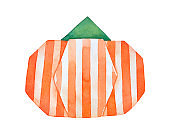 """Bright striped origami pumpkin with green stem. Hand painted watercolour graphic illustration on white background, cutout clip art element for design, """"Happy Thanksgiving"""" tag, package decoration."""