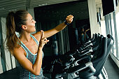 Woman is using smart watch during her workout