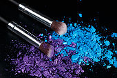 Crushed eyeshadows and make-up brushes