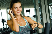 Woman using smart watch in the gym