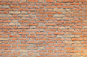 wide wall made with red bricks
