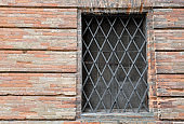old palace with windows and metal grate