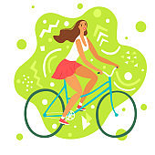 Beautiful young woman riding a bicycle.
