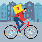 Delivery man riding on a bicycle with bacpack with a cityscape behind