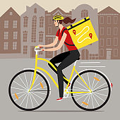Delivery woman riding on a bicycle with bacpack with a cityscape behind