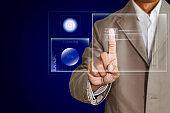 Businessman scanning fingerprint on transparent screen, futuristic biometric security system concept