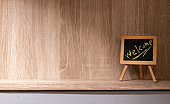 """chalkboard with """" welcome """" message on wood floor"""