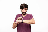 Excited brunet bearded man with moustaches checking notification with smart watches. Using modern technologies in everyday life.